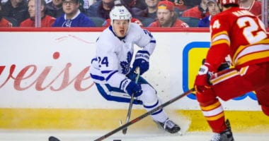 Kasperi Kapanen of the Toronto Maple Leafs and Travis Hamonic of the Calgary Flames