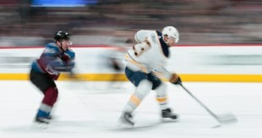 Sam Reinhart of the Buffalo Sabres and Dan Girard of the Colorado Avalanche