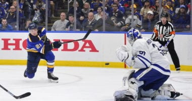 Tyler Bozak of the St. Louis Blues and Frederik Andersen of the Toronto Maple Leafs