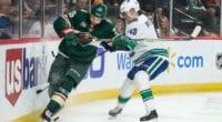 Elias Pettersson of the Vancouver Canucks and Jonas Brodin of the Minnesota Wild