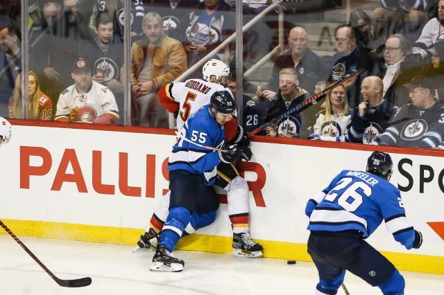 Mark Scheifele of the Winnipeg Jets and Mark Giordano of the Calgary Flames
