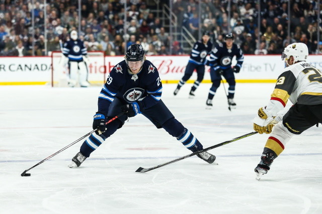 Latest on Winnipeg Jets speculation involving Laine, Roslovic and Lewis. The pros and cons of the Los Angeles Kings trading for Dubois.