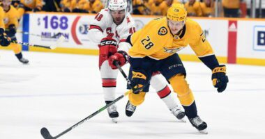 Coyotes sign 2021 first-round pick Dylan Guenther. Blackhawks file MacKenzie Entwistle contract. Predators sign Eeli Tolvanen for three years
