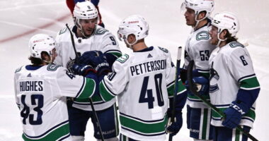 Travis Hamonic doesn't opt-out. The Vancouver Canucks officially sign restricted free agents Elias Pettersson and Quinn Hughes.